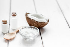 Cosmetic concept with fresh coconuts on white table background mock up Royalty Free Stock Images