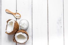 Cosmetic concept with fresh coconuts on white table background top view Stock Photos