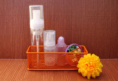 Cosmetic container and mirror in basket Royalty Free Stock Photo
