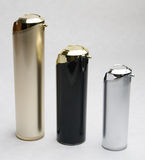 Cosmetic Containers. Different metallic containers and bottles used for storing cosmetic products Stock Photos