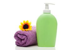 Cosmetic containers,towel and sunflower Stock Images