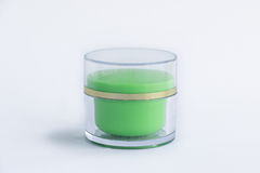 Cosmetic cream bottle in green color Stock Photos