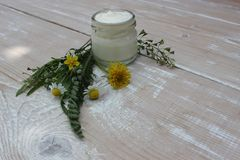Cosmetic cream with chamomile flowers stock photos