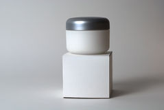 Cosmetic cream container and box Royalty Free Stock Photo