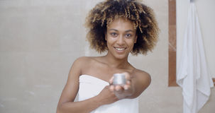 Cosmetic Cream Container In Woman Hand Stock Images