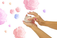 Cosmetic cream in female hands Royalty Free Stock Photography