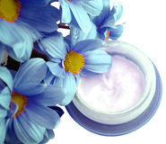 Cosmetic cream with flowers Stock Photo