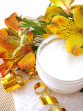 Cosmetic cream with flowers stock photography