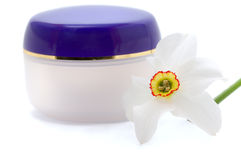 Cosmetic cream with flowers Stock Images