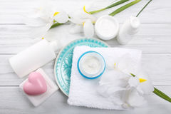 Cosmetic cream in glass jar and other bath accessories on wooden Royalty Free Stock Image