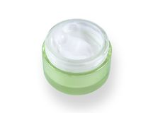 Cosmetic cream in a green jar. Face cream in open glass jars Royalty Free Stock Image