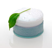 Cosmetic cream and green leaf Royalty Free Stock Photo