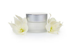 Cosmetic cream jar and flowers Stock Photo