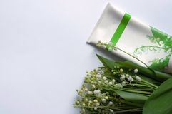 Cosmetic cream and lily of the valley flowers  on white background stock images