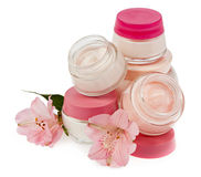Cosmetic cream for make-up and fresh flowers isolated on white b Royalty Free Stock Photo