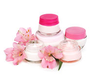 Cosmetic cream for make-up and fresh flowers isolated on white b Royalty Free Stock Photography