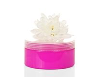 Cosmetic cream in pink container and flower Royalty Free Stock Photos