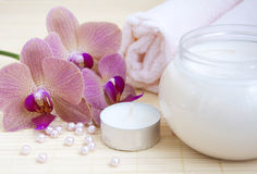 Cosmetic  cream with pink orchids and towel Stock Image