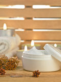 Cosmetic cream product with candles on wooden. Stock Photos