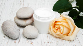 Cosmetic cream with spa stones and rose Stock Images
