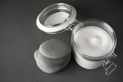 Cosmetic cream and stones Royalty Free Stock Photos