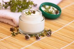 Cosmetic cream and thyme Royalty Free Stock Images