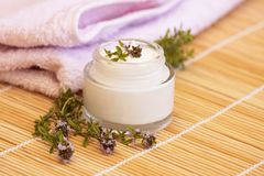 Cosmetic cream and thyme Royalty Free Stock Photos