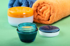 Cosmetic cream and towels Royalty Free Stock Image