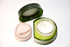 Cosmetic creams. Containers of three different cosmetic creams Royalty Free Stock Photo