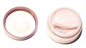Cosmetic creams. Containers pink different cosmetic creams Stock Photos
