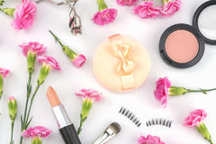 Cosmetic decorated with pink carnation Royalty Free Stock Photo