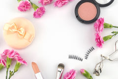 Cosmetic decorated with pink carnation Stock Image