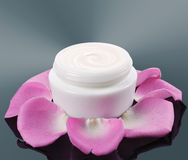 Cosmetic face cream on a grey background Stock Images