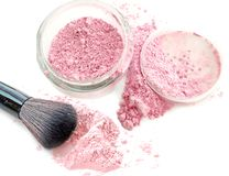 Cosmetic face powder on white and blush. Royalty Free Stock Images