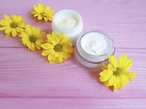 Cosmetic facial cream skin care protection treatment container handmade organic product daisy flowers on a pink wooden Royalty Free Stock Image