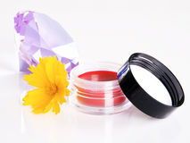 Cosmetic with a flower and violet crystal Royalty Free Stock Photos