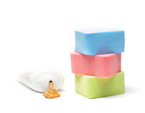 Cosmetic foundation and colorful sponges Royalty Free Stock Images
