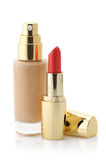 Cosmetic foundation and lipstick Royalty Free Stock Photos
