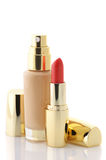 Cosmetic foundation and lipstick Royalty Free Stock Photography