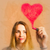 Cosmetic girl drawing love heart with lipstick Stock Photos