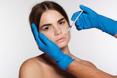 Cosmetic hyaluronic acid injection to woman's lips Royalty Free Stock Images