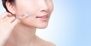 Cosmetic injection in the female lips Stock Photos