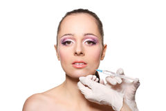 Cosmetic injection to female face. Royalty Free Stock Images