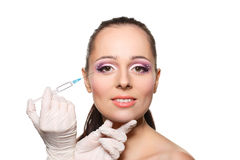 Cosmetic injection to female face. Royalty Free Stock Photo