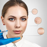 Cosmetic injection to the pretty female face. Royalty Free Stock Image