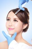 Cosmetic injection to the pretty woman face Royalty Free Stock Image
