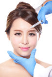 Cosmetic injection to the pretty woman face Royalty Free Stock Images