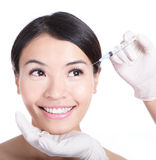 Cosmetic injection in woman face Stock Image