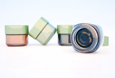 Cosmetic jars of clay isolated on a light background. Royalty Free Stock Image