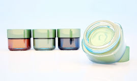 Cosmetic jars of clay isolated on a light background. One jar is Stock Images